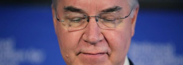 Tom Price looks downward during a press briefing file photo