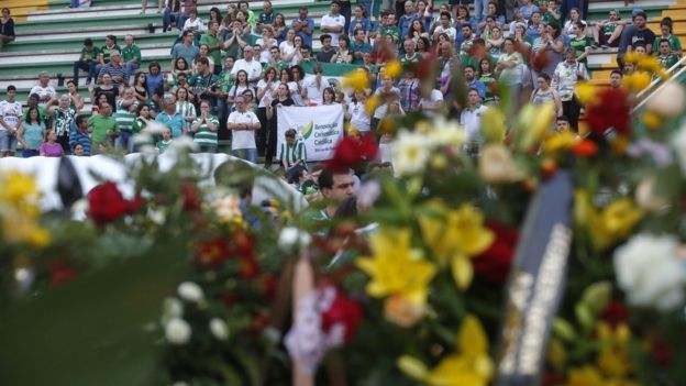 Supporters of Brazilian soccer team Chapecoense attend a vigil ahead of the 3 December tribute to the club's victims of the plane accident in Colombia, at Arena Conda stadium in Chapeco, Brazil, 2 December 2016.