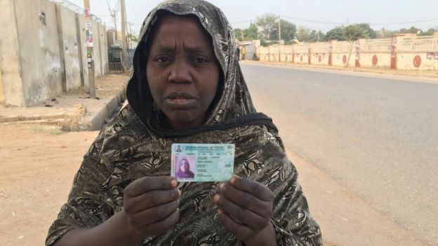 Woman holding a voter's card