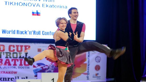Katerina Tikhonova dances with Ivan Klimov during the World Cup Rock'n'Roll Acrobatic Competition in Krakow, 2014
