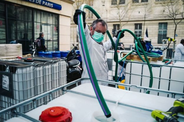 A pharmacy in Paris's Latin Quarter has started making sanitiser in the street