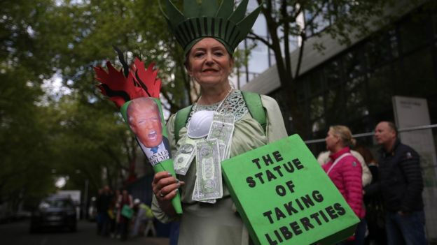 A woman protestor holding signs