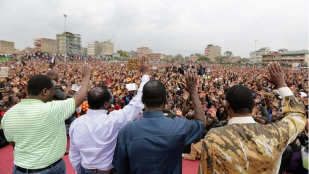 Members of the The National Super Alliance (NASA) including Odinga appear on stage in front of supporters after the supreme court decision was announced