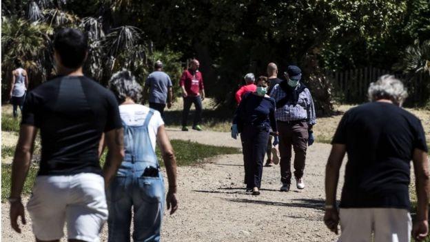 People walk in the park of Villa Pamphili during phase two of the emergency block of the Coronavirus Covid-19 in Rome, Italy, 08 May 2020