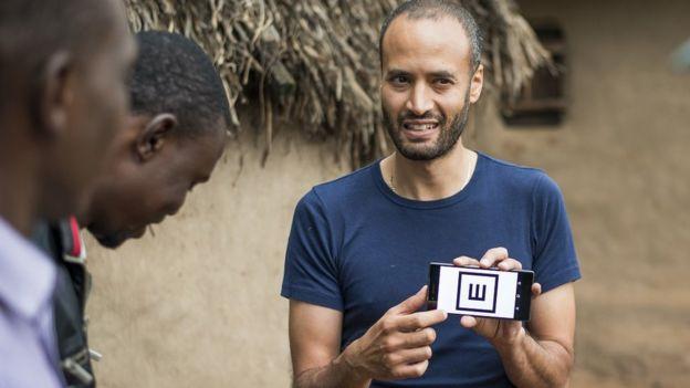 Dr Andrew Bastawrous demonstrates the Peek Acuity app to villagers in Kenya