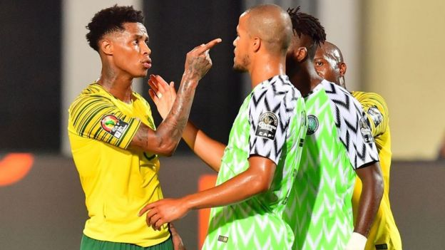South African midfielder faces up to Nigerian defender William Ekong in a 2019 Africa Cup of Nations game
