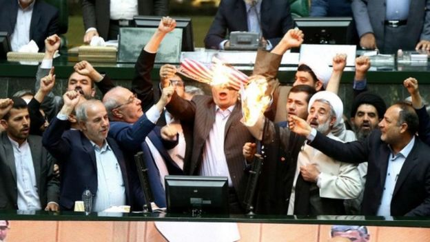 Iranian parliamentarians burn a US flag