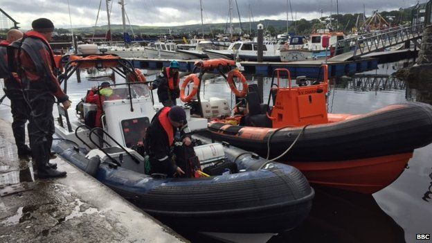 The scientists load up the boats before heading out to sea