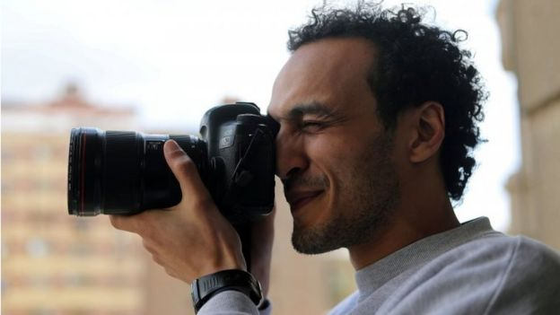 Egyptian award-winning photographer Mahmoud Abu Zeid, also known as Shawkan, takes pictures after his release, at his home in Cairo, Egypt, on 4 March 2019.
