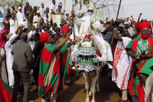 The Emir of Kano Muhammadu Sanusi II departs on horseback from the Eid prayer ground in Kano, Nigeria - 25 June 2017