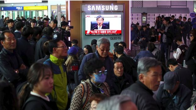 South Koreans watch as the verdict is broadcast live