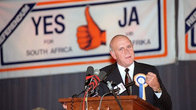Souh African President Frederik Willem de Klerk clenches his fist as he addresses a packed hall of mostly students at the normal teachers' training college in Pretoria during his referendum rally, on March 13, 1992