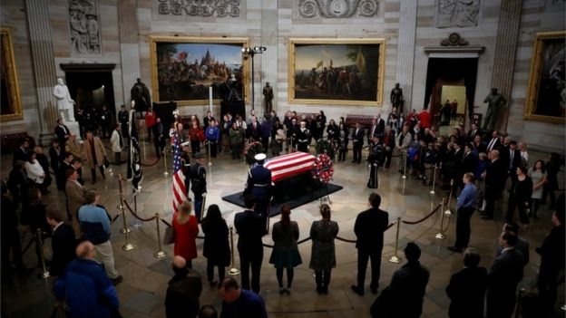 Mourners pay their respects at the casket of former U.S. President George H.W. Bush as it lies in state inside the U.S. Capitol Rotunda on Capitol Hill