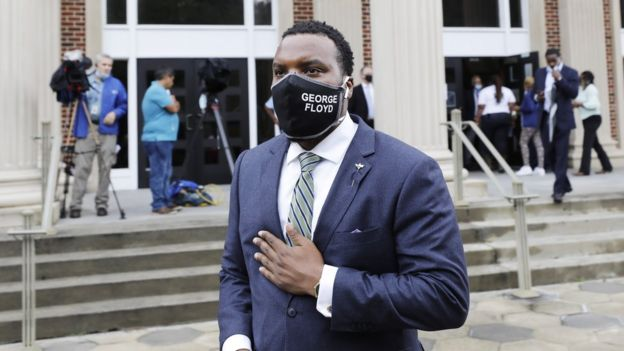 Arbery family lawyer S Lee Merritt in a face mask with George Floyd written on it