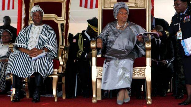 Liberian President Ellen Johnson Sirleaf (R) and Liberian Vice President Joseph N. Boakai (L) attend Sirleaf's second presidential inauguration in Monrovia on January 16, 2012.