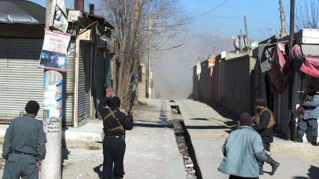 Dust blows down a street after one of the explosions