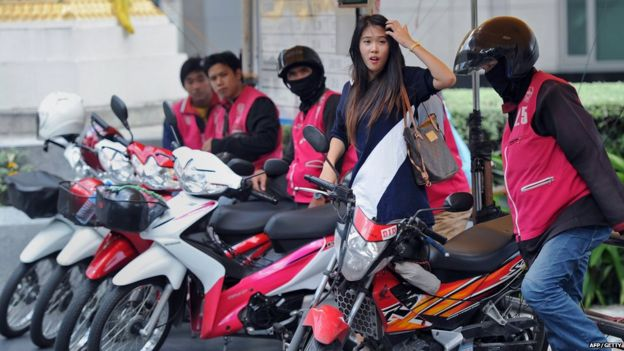 Asian motorcycle taxi commit error
