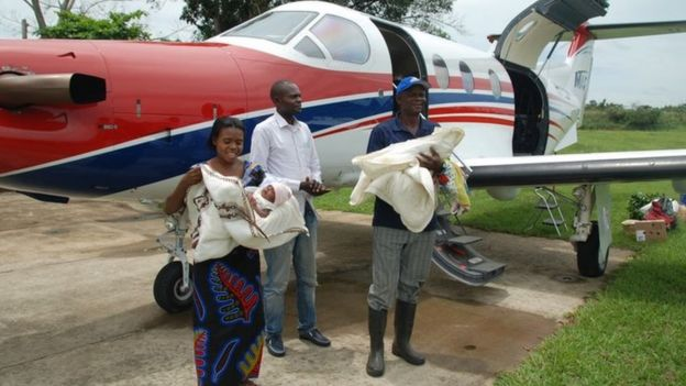 The twins and family after being flown back to their region