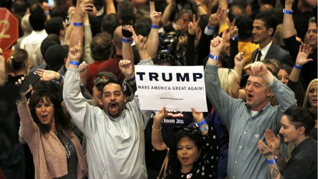 Supporters of Republican U.S. presidential candidate Donald Trump celebrate as television networks declare him the winner of the Nevada Republican caucuses at Trump's Nevada caucus rally in Las Vegas, Nevada, on 23 February 2016.