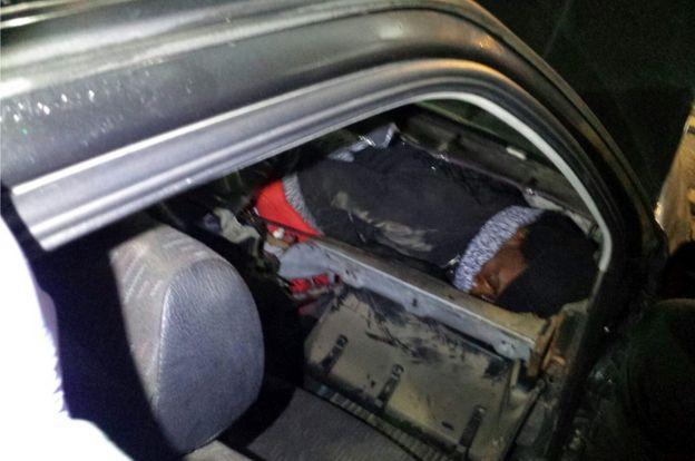 African migrant hiding in car dashboard, 2 Jan 17 (Spanish Civil Guard photo)