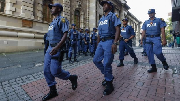 South African police officers outside the KwaZulu-Natal High Court in Durban.