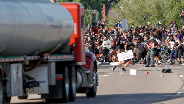 A tanker truck drives into thousands of protesters marching on a highway in Minneapolis, Minnesota, during a protest against the death in police custody of George Floyd, 31 May 2020