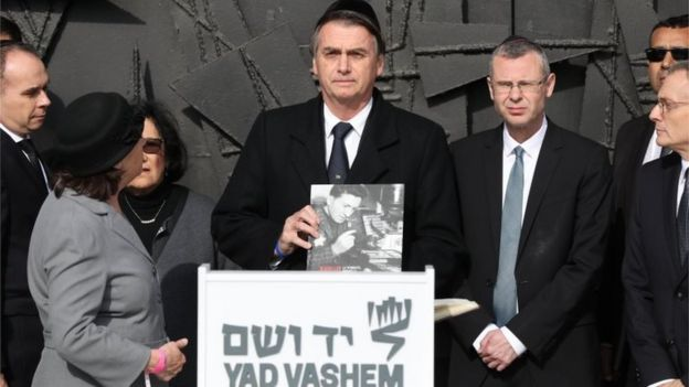 Brazilian President Jair Bolsonaro (C) during a memorial ceremony at the Hall of Remembrance in the Yad Vashem Holocaust memorial museum in Jerusalem, Israel, 02 April 2019.