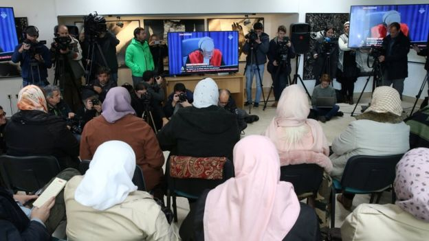 Victims and their family members watch a television broadcast of the court proceedings of former Bosnian Serb general Ratko Mladic in the Memorial centre Potocari near Srebrenica,