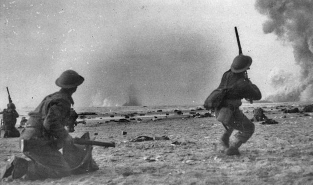 British soldiers shoot rifles at German aircraft attacking rescue ships at Dunkirk