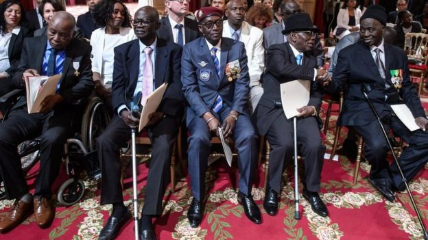 African war veterans at a citizenship ceremony in France