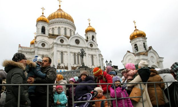 The faithful stand in a line to enter the Moscow Christ the Saviour Cathedral in 2011, to see an Orthodox relic, the Belt of the Virgin Mary from Mount Athos.