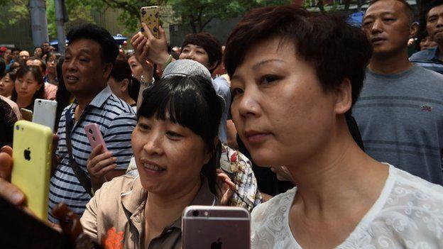 Parent wait outside exam hall
