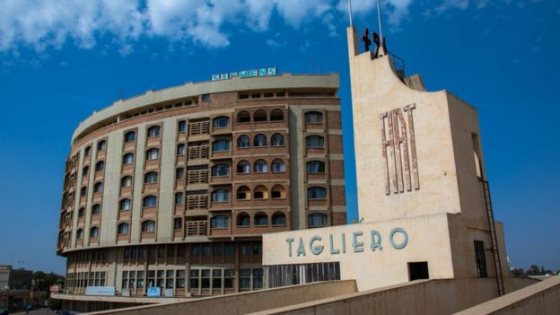 Futurist architecture of the FIAT tagliero service station built in 1938 in front of nakfa house, Central region, Asmara, Eritrea on August 22, 2019 in Asmara, Eritrea
