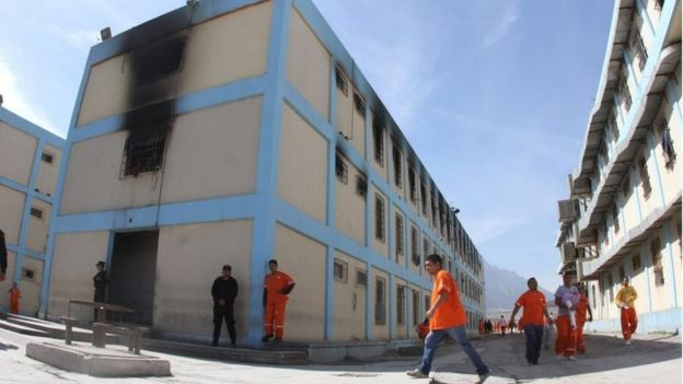 A handout picture provided by the Government of Monterrey shows police officers conducting a search in the Topo Chico Prison in Monterrey, Mexico, 14 February 2016