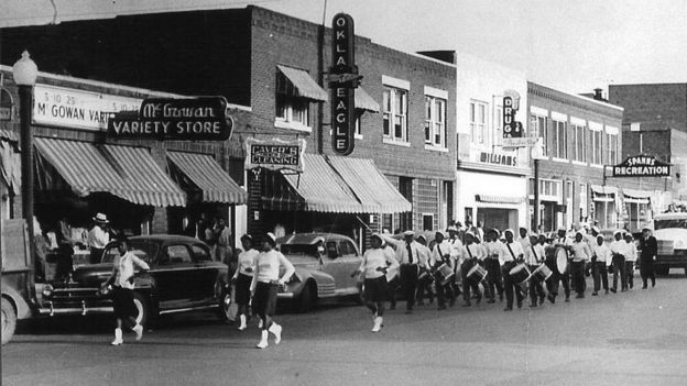 A marching band in the streets of Greenwood, prior to 21 June 1921