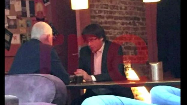 Screengrab with watermark shows Carles Puigdemont in a Belgian cafe on the day he is due in Madrid