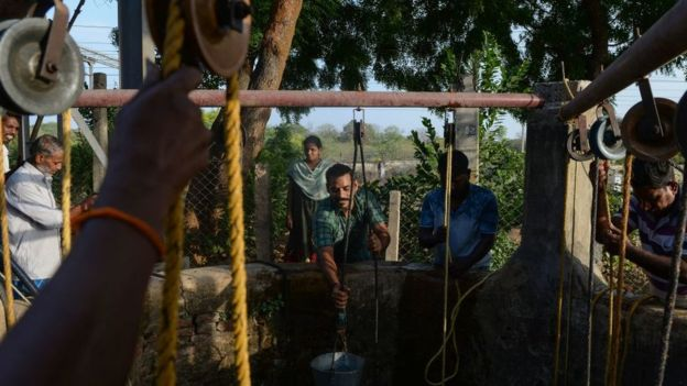 In this photo taken on June 20, 2019, Indian residents collect water from a community well in Chennai after reservoirs for the city ran dry.