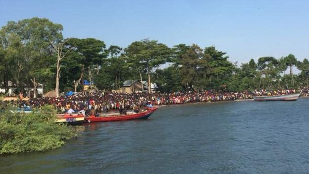 Crowds watch rescue efforts after a boat capsized in Tanzania