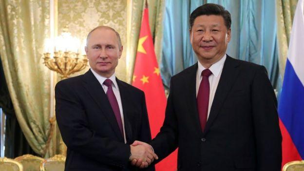 Vladimir Putin y Xi Jinping,