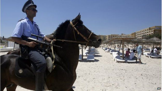 A Tunisian police officer on horse patrol the beach in front of the Imperial Marhaba Hotel in Sousse