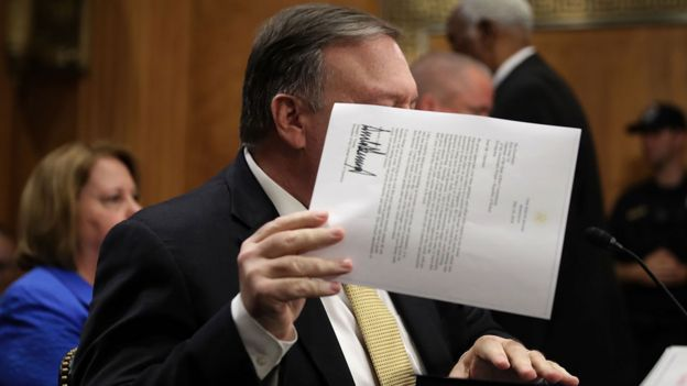 Pompeo holds up letter