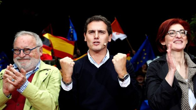 Ciudadanos party leader and candidate for PM, Albert Rivera (C), Spanish philosopher Fernando Savater (L) and Euro MP Maite Pagazaurtundua (R), attend a party election campaign event at a square in town of Errenteria, Basque Country