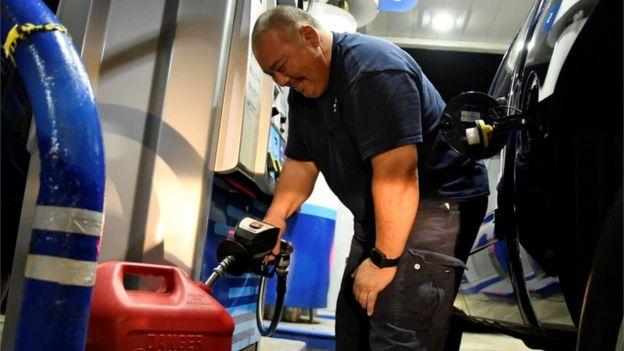 Man filling gas