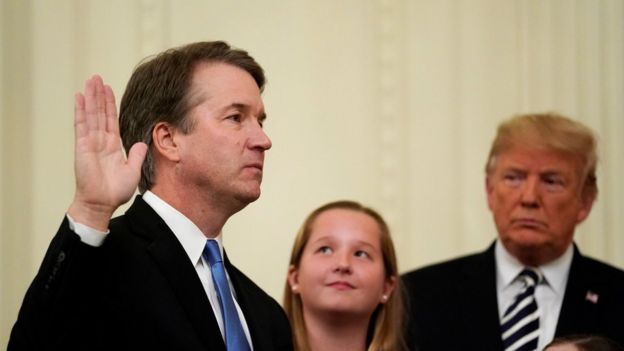 US Supreme Court Associate Justice Brett Kavanaugh is sworn in while his daughters and US President Donald Trump look on, 8 October 2018