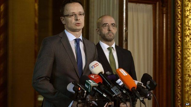 Peter Szijjarto (left) speaks during a press conference in Budapest in Hungary on 17 June 2015.