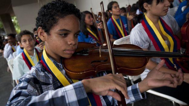 A Venezuelan young musician of 'El Sistema' plays during a free concert at Teresa Carreno theatre in Caracas February 16, 2012
