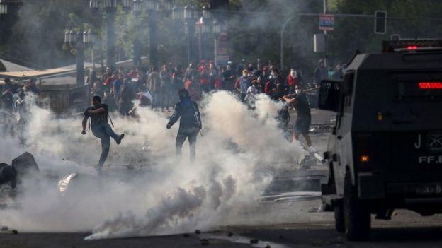 Demonstrators clash with soldiers in Santiago