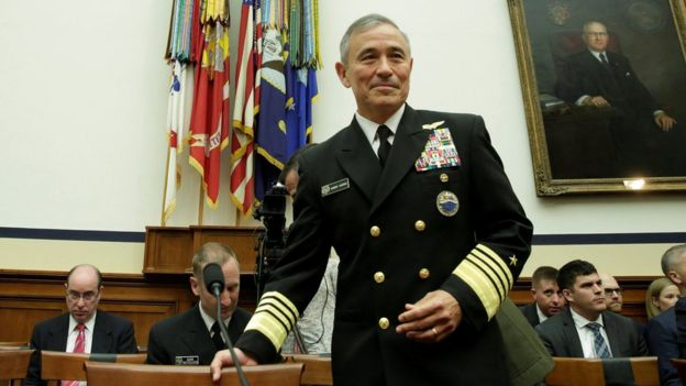 Admiral Harry Harris prepares to testify before a House armed services committee hearing on