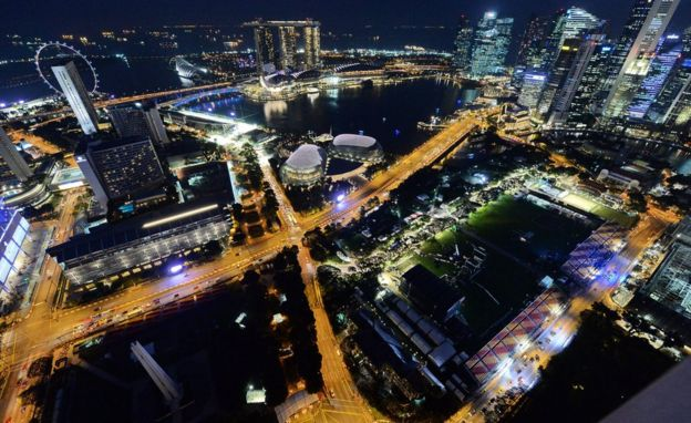 An aerial view of Singapore lit up at night