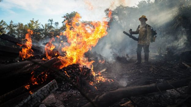 A firefighter in the Amazon